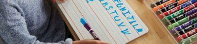 girl-writing-alphabet-on-lined-whiteboard_bp2t.jpg