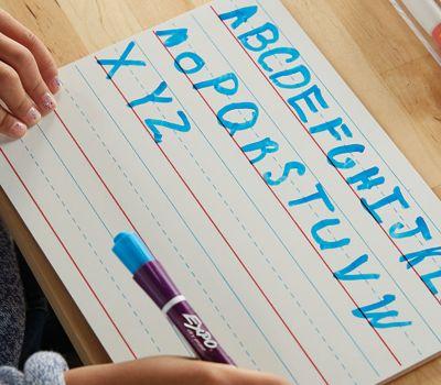 girl-writing-alphabet-on-lined-whiteboard_bp3p.jpg