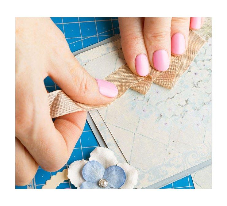 gluing-ribbon-down-to-scrapbook-page_bp3p.jpg