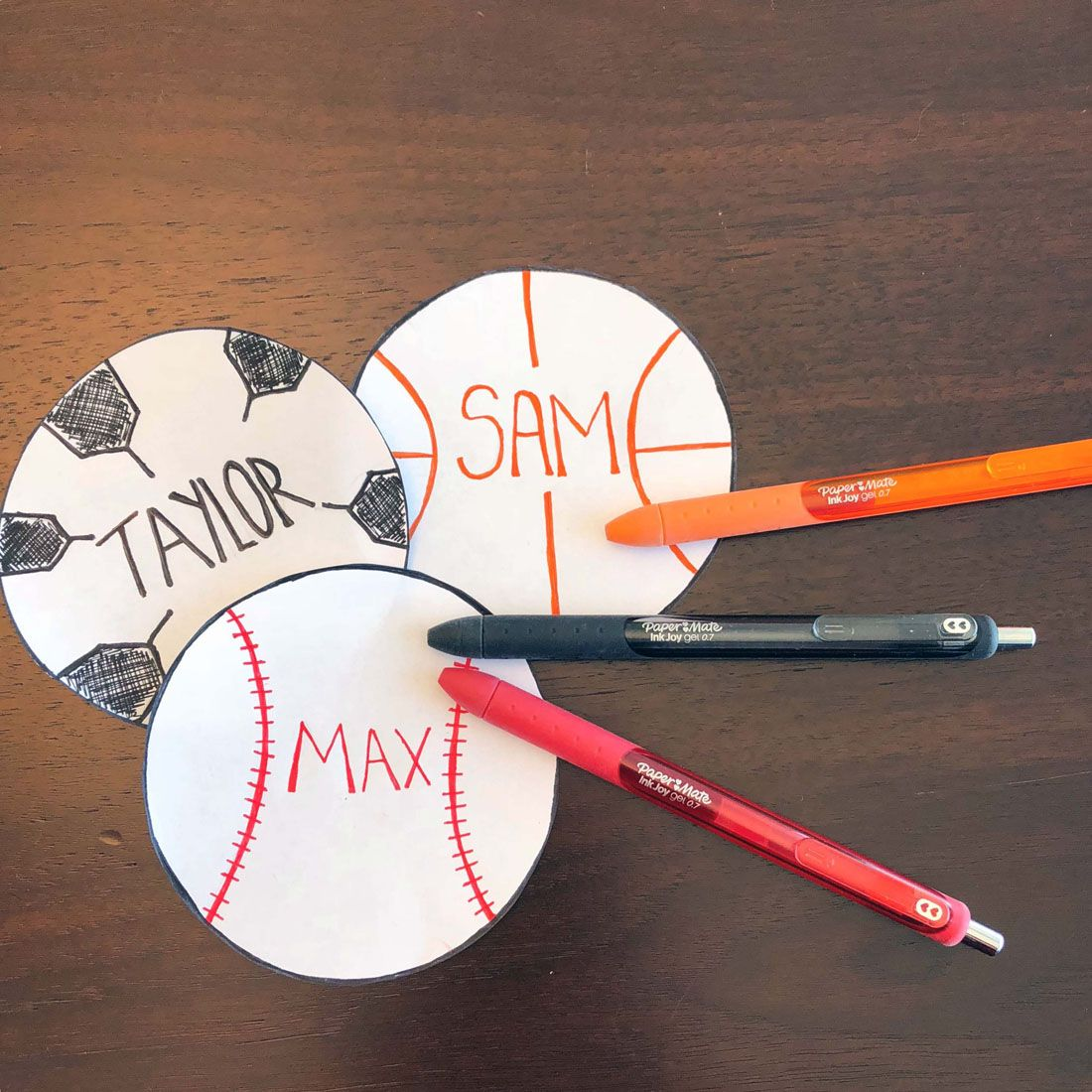 handwritten-sports-themed-name-tags-using-papermate-inkjoy-gel-pens (1100×1100)