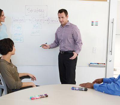 man-presenting-in-front-of-peers-at-whiteboard_bp3p.jpg