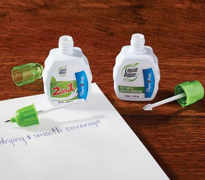 papermate-liquid-paper-correction-bottles-near-notebook_bp3p.jpg