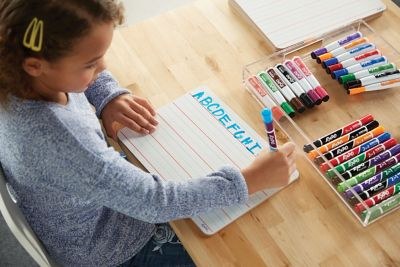 student-working-with-individual-whiteboard-and-colorful-expo-markers.jpg