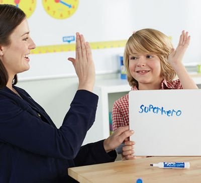 teacher-high-fiving-student-in-classroom.jpg