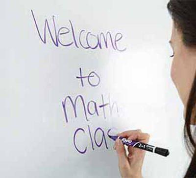 teacher-writing-welcome-to-math-class-on-whiteboard.jpg