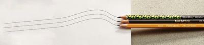 three-woodcase-pencils-drawing-lines-on-paper_bp2t.jpg
