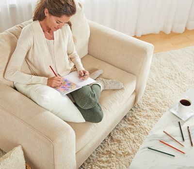woman-coloring-in-comfy-chair-using-prismacolor-colored-pencils_bp3p.jpg