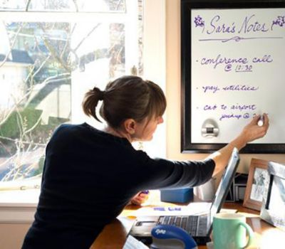 woman-writing-on-whiteboard-at-desk_bp3p.jpg