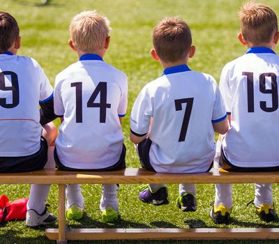 young-boys-in-soccer-gear-sitting-on-bench_bp3p.jpg