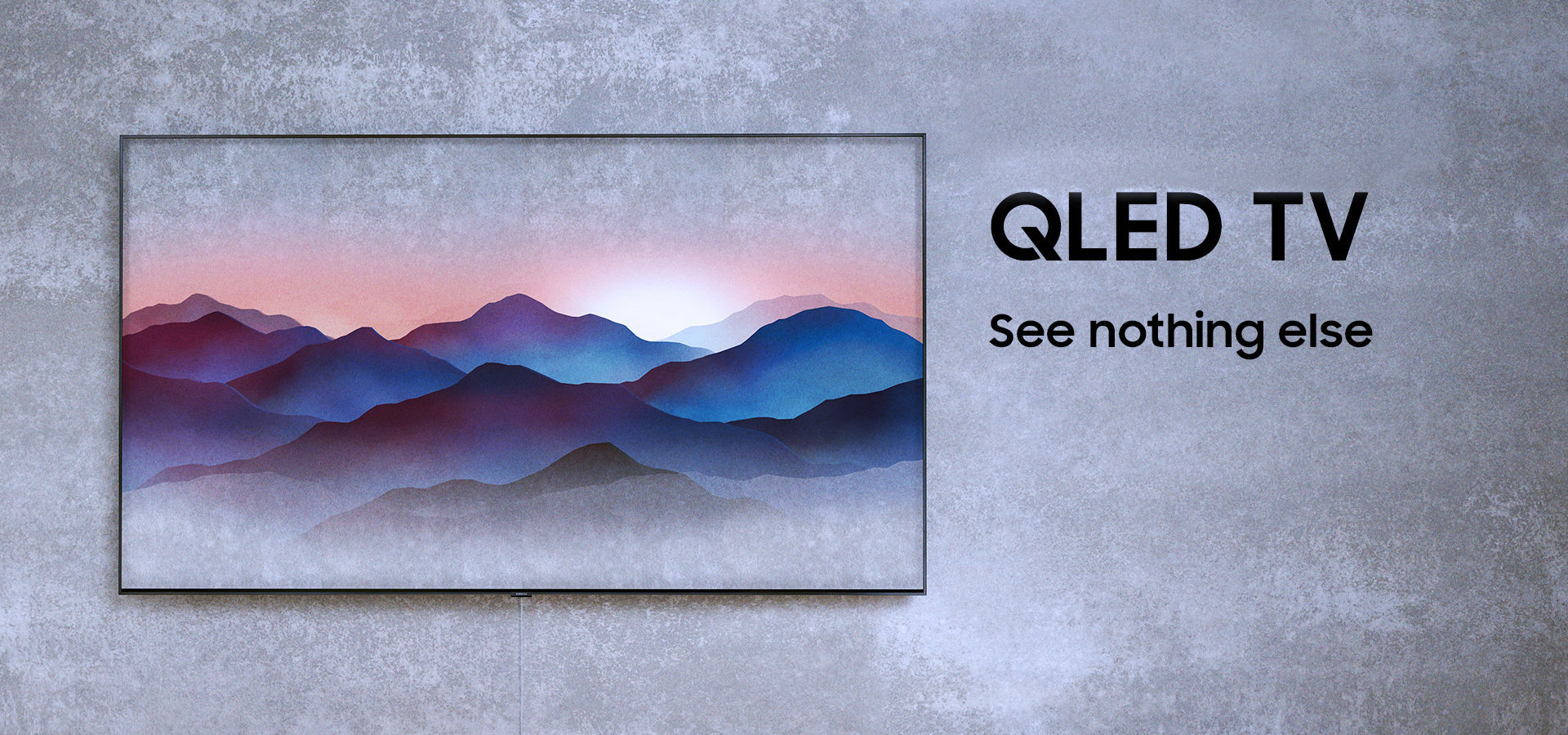 Three angles of Samsung's new QLED TVs are put on the floor in dark room. Left far one is facing back, middle one ins facing right front with Ambient Mode onscreen on and the right closest one is facing back.