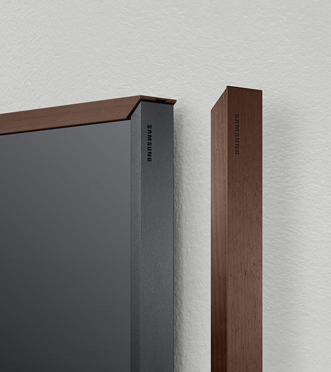 samsung tv the frame. closeup of the walnut color bezels. bezel on right is apart from samsung tv frame
