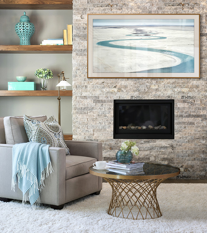 The Frame is mounted on brick wall in living room above a fireplace displaying a photograph in Modern layout with Antique matte color.