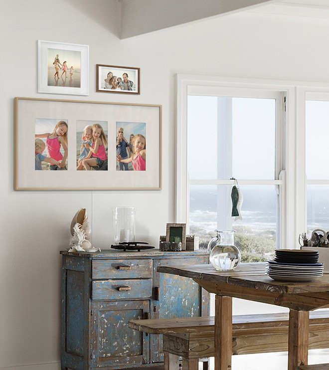 The Frame displaying three photographs in Triptych layout with antique matte color, hanging on the wall in dining room.