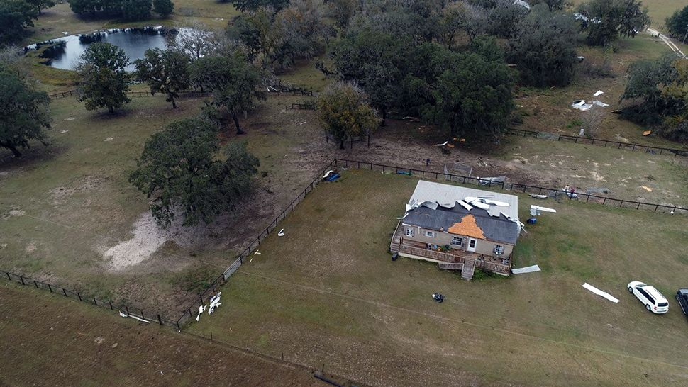 The roof of this home in Mascotte was severely damaged by strong winds on Thursday, January 24, 2019. (Tony Rojek/Spectrum News 13)