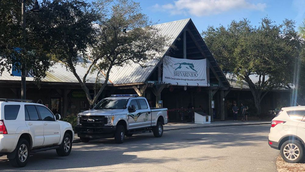 FWC officials outside the Brevard Zoo, where a child fell into a rhino exhibit. (Vincent Earley, Spectrum News)