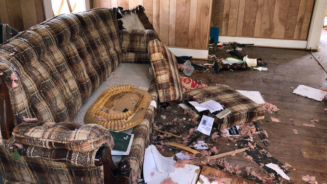Damage to a living room done to a home by morning storms in Groveland. (Tony Rojek/Spectrum News 13)