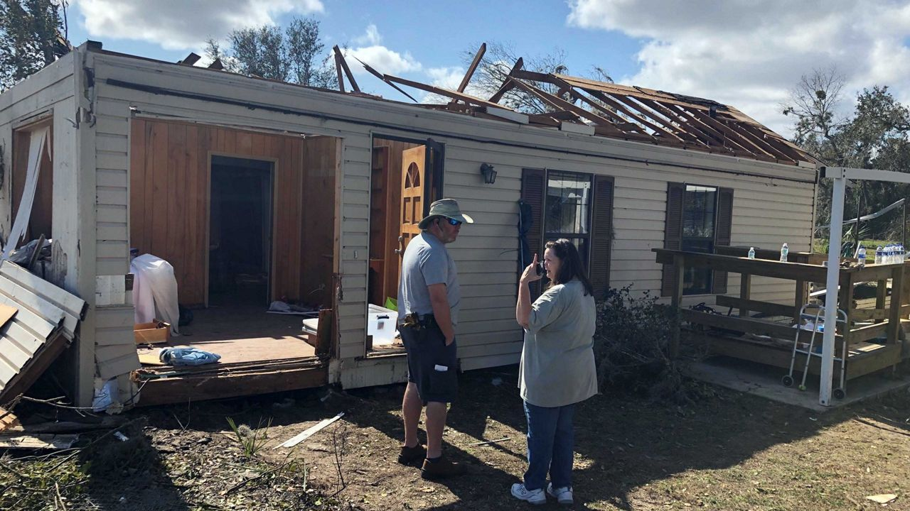 Neighbors and community helps salvage what they can from Groveland storm damage. (Tony Rojek/Spectrum News 13)
