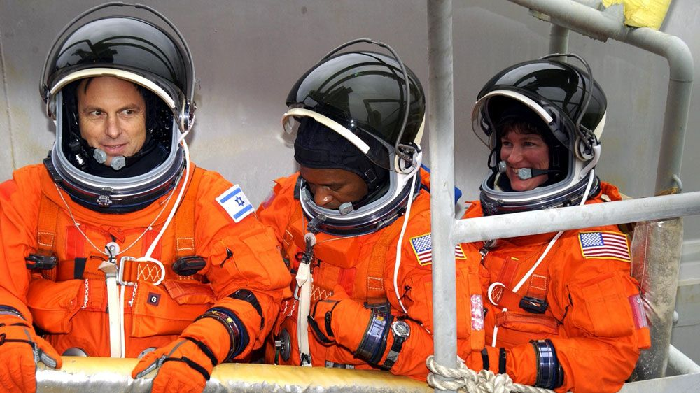 The STS-107 crew in their flights suits. (NASA)