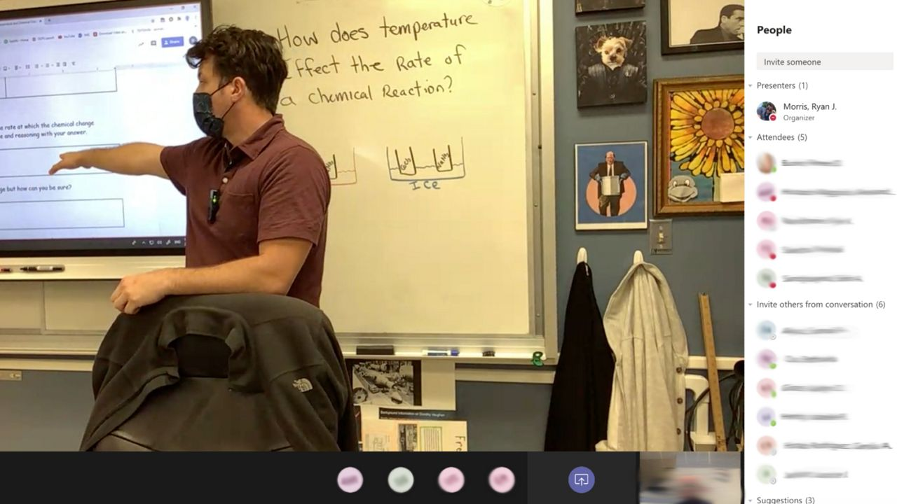 Teacher Ryan Morris goes over a written exercise after a lab experiment in his 8th-grade science class at Windy Ridge K-8. (Screen capture)
