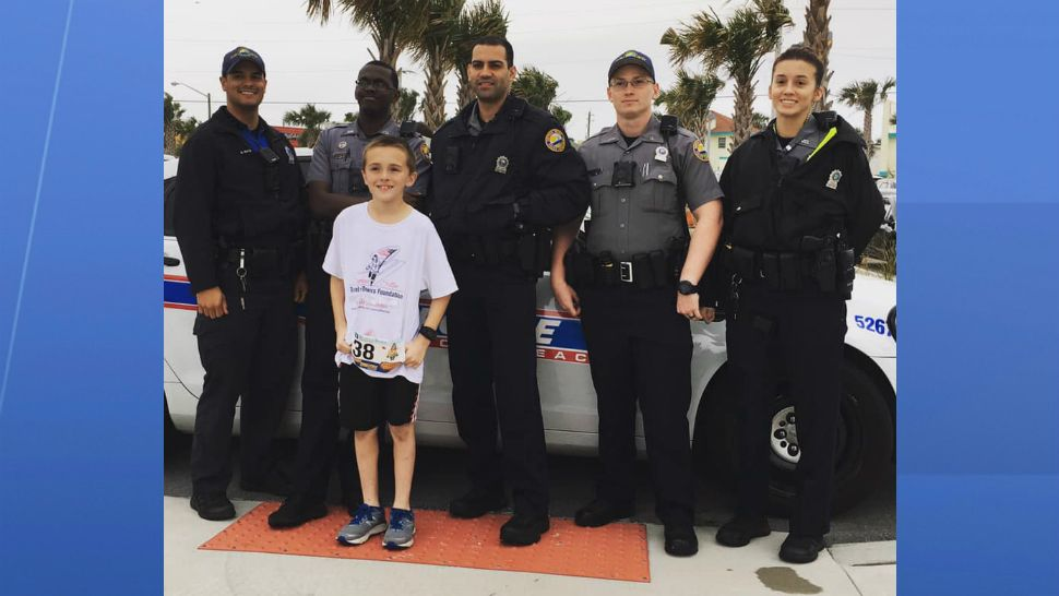 During his runs, Zechariah Cartledge, 10, is often greeted by law enforcement officers who park their cars and flash their lights in support. (Courtesy of Cartledge family)