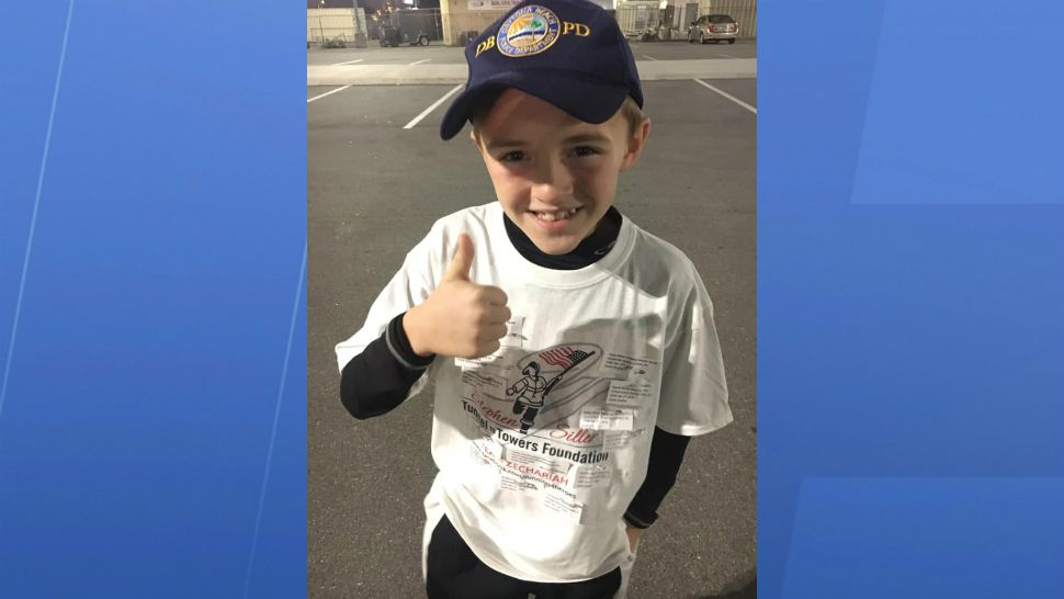 Zechariah Cartledge, 10, of Winter Springs is trying to run 144 miles this year — 1 for each officer who died in the line of duty last year. (Courtesy of Cartledge family)