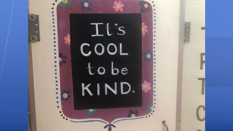 A small group of students at Carlton Palmore Elementary in Lakeland have painted motivational messages on bathroom stalls. (Stephanie Claytor/Spectrum News)
