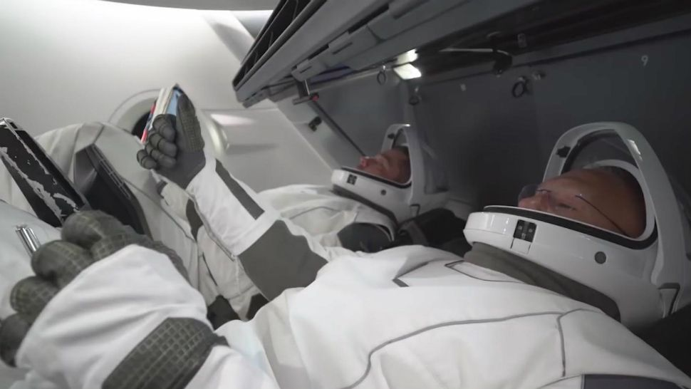 An undated promotional video for the Crew Dragon depicts several astronauts aboard the spacecraft. (SpaceX)