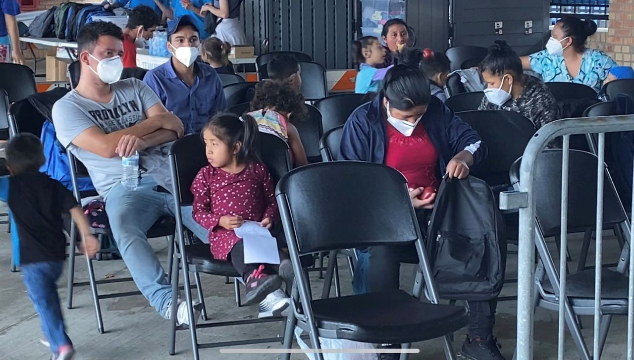 Migrants wait to be processed at a Brownsville bus station. (Spectrum News 1)