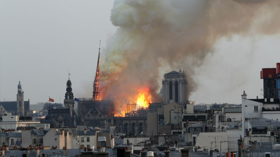 Flames rise from Notre Dame cathedral in Paris as it burns Monday, April 15, 2019. (Thibault Camus/AP)