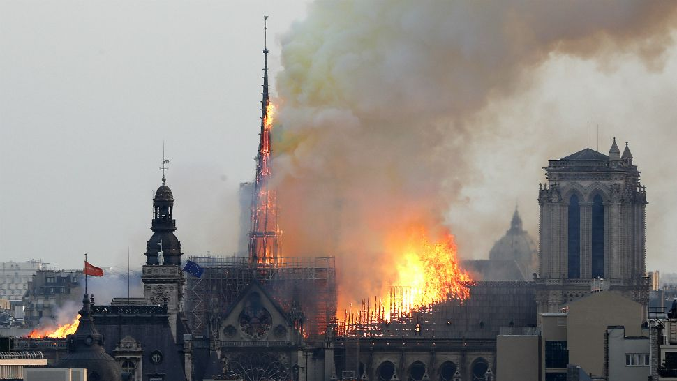 Flames engulf the spire of Notre Dame cathedral in Paris on Monday, April 15, 2019. (Thibault Camus/AP)
