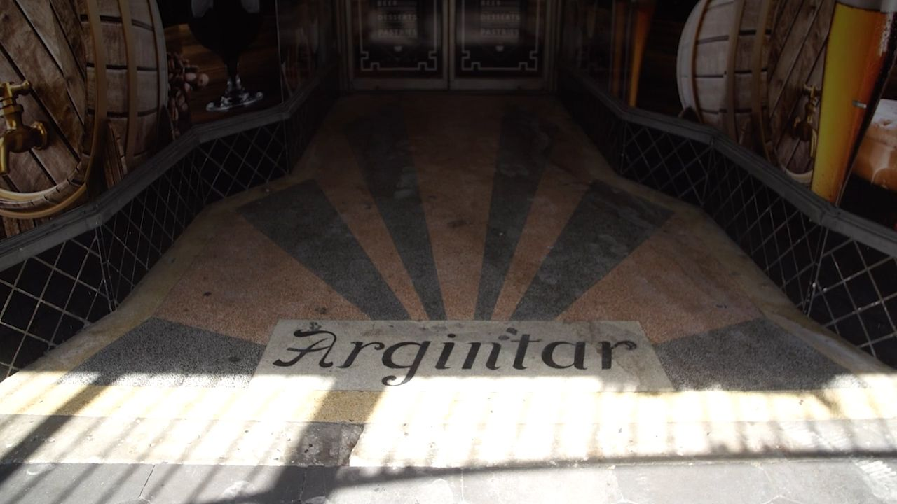 The sidewalk in front of the Argintar family's storefront still bears their family name.