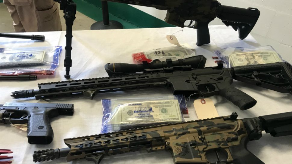 These are some of the drugs, weapons, and cash seized during a massive opioid-trafficking investigation in Brevard County, Sheriff Wayne Ivey said Wednesday. (Greg Pallone/Spectrum News 13)