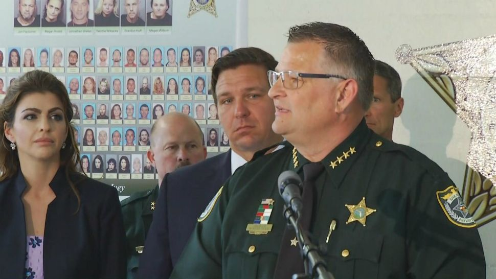 Brevard County Sheriff Wayne Ivey on Wednesday announces that a monthslong opioid-trafficking investigation was the largest of its kind in county history. He was joined in the news conference by Florida first lady Casey DeSantis (far left) and Gov. Ron DeSantis (behind Ivey).