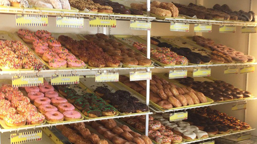 Shelves full of doughnuts at Donut King in Winter Park.