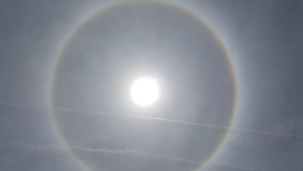 Giant ring around the sun, called a sun halo, seen over Merritt Island on Thursday.