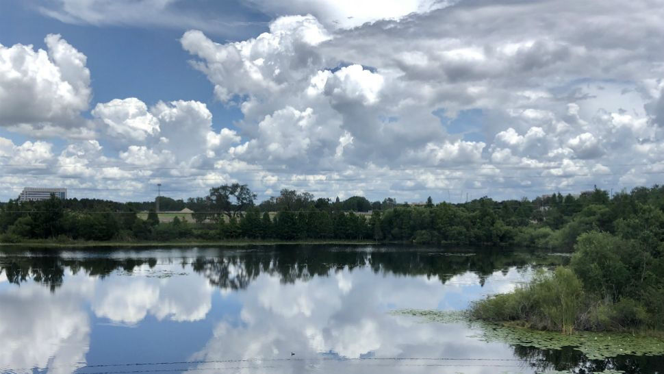 Clouds build over Big Sand Lake in the Dr. Phillips area of Orlando on Friday afternoon, May 18, 2018.