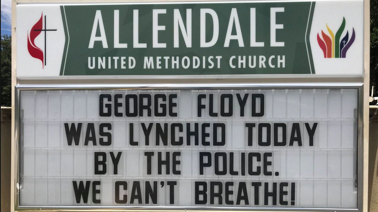 """Message on Allendale United Methodist Church marquee that reads """"George Floyd was lynched today by the police. We can't breathe."""" (Trevor Pettiford/Spectrum Bay News 9)"""