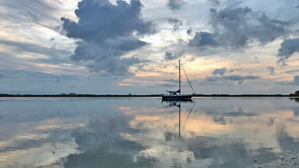 Sent via Spectrum News 13 app: A little sailboat looking peaceful at Little Beach in Edgewater on Thursday, June 07, 2018. (Alicia Watson, viewer)