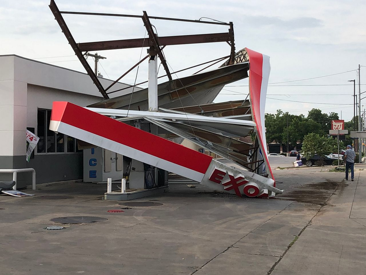 The roof of an Exxon Gas Station was destroyed by strong winds in Lockhart, Texas on Sunday.