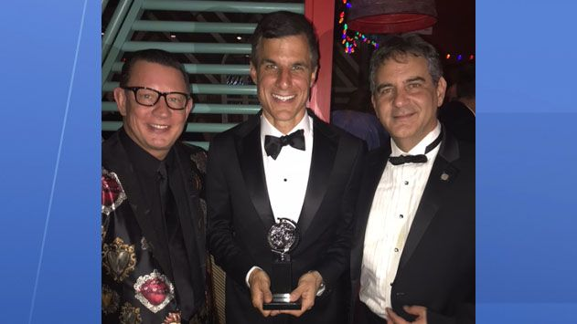 Dr. Jeffrey Grove (left) stands with fellow producers with their Tony Award for Best Revival of a Musical.