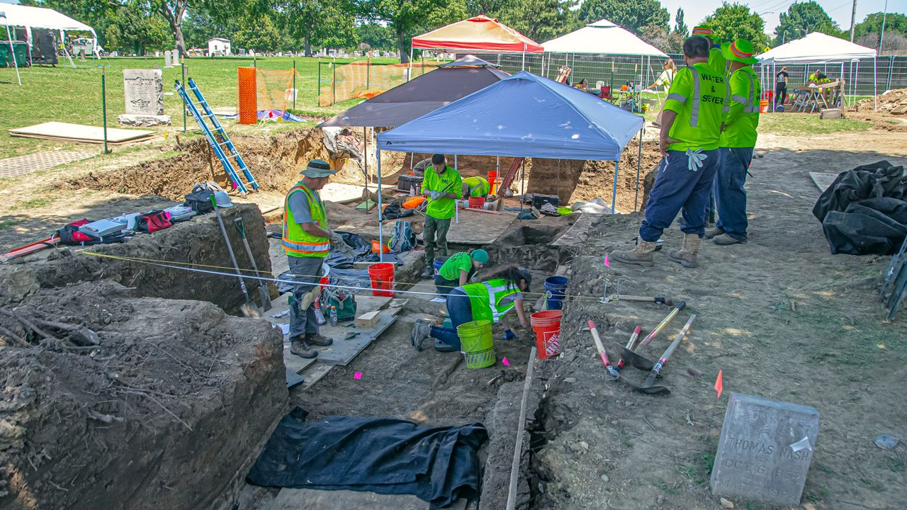 Dr. Stubblefield's team works to unearth graves at Oaklawn Cemetery in Tulsa.