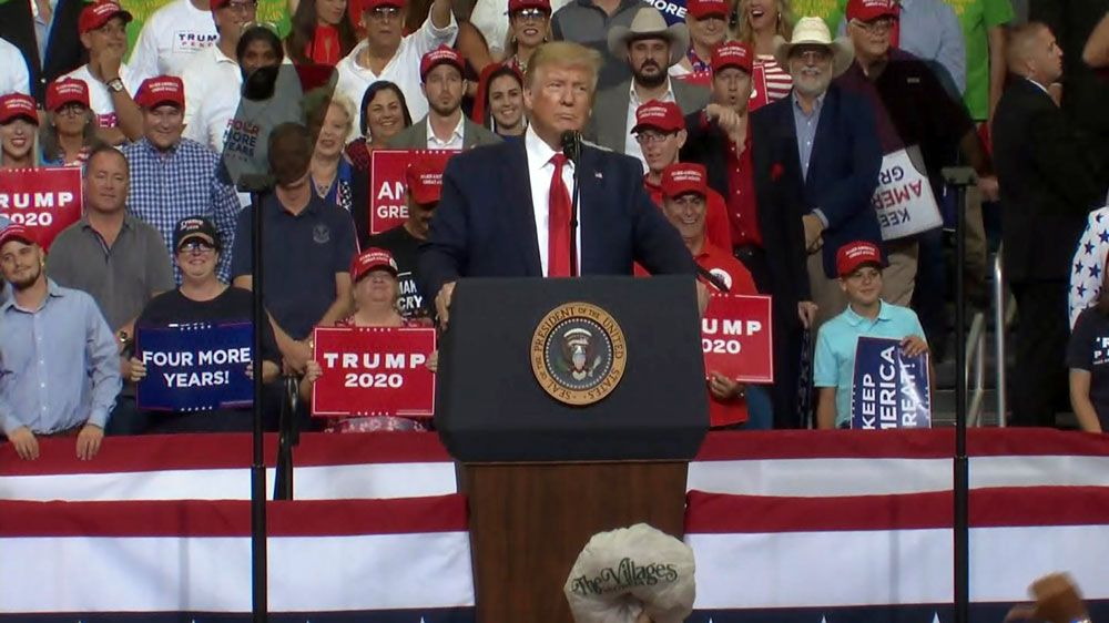 "President Donald Trump tells a mostly-full Amway Center crowd Tuesday night that he's been tough on Russia and that the left wants to ""radicalize our judiciary."" (Spectrum News)"