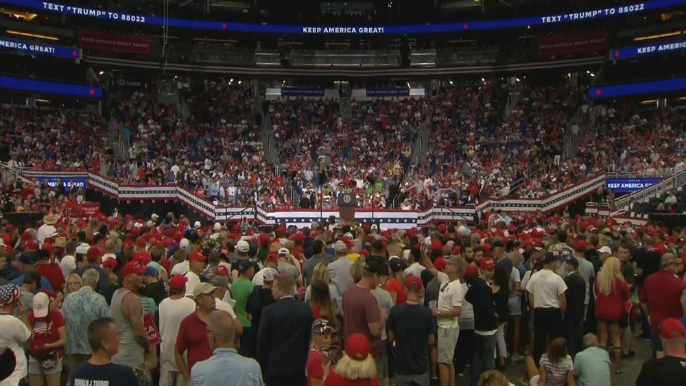 Supporters of President Donald Trump have poured into the Amway Center in downtown Orlando ahead of an appearance by the president Tuesday night. Vice President Mike Pence as well as the president's son, Donald Trump Jr., were expected to take the stage. (Spectrum News)