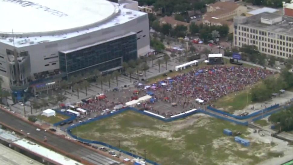 A large crowd celebrates in front of the Amway Center on Tuesday afternoon ahead of President Donald Trump's campaign event in the evening. (Sky 13)