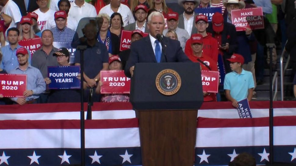 Vice President Mike Pence takes the stage during President Donald Trump's re-election bid announcement at the Amway Center in downtown Orlando. (Spectrum News)