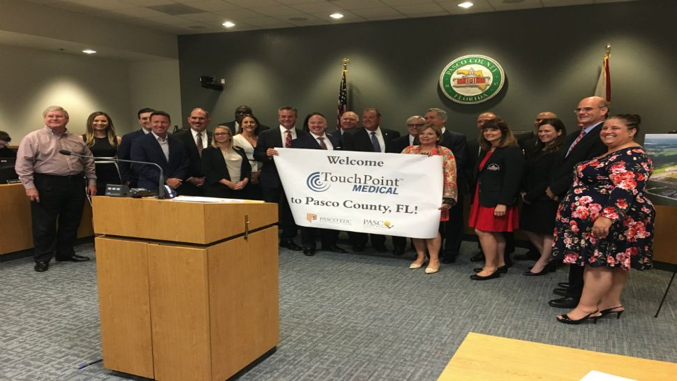 Pasco County Commissioners and TouchPoint officials shortly after the board approved an incentive package to help bring the company to Pasco.