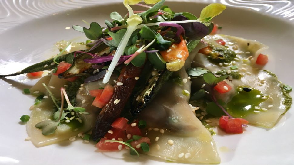 This is Soco's vegan smoked black eyed pea ravioli entrée.