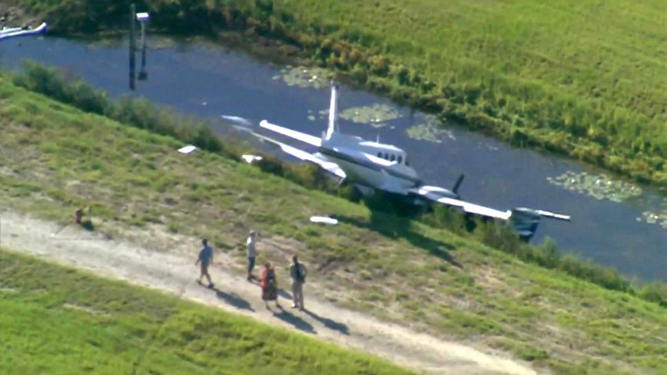 A small airplane ran off a runway at Orlando Executive Airport and into a water-filled ditch Monday morning, June 25, 2018.