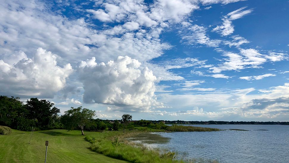 Submitted via the Spectrum News 13 app: Big Sand Lake from the Dr. Philips side saw some beautiful blue skies and bright, white clouds on Monday, July 09, 2018. (Karen Lary, viewer)