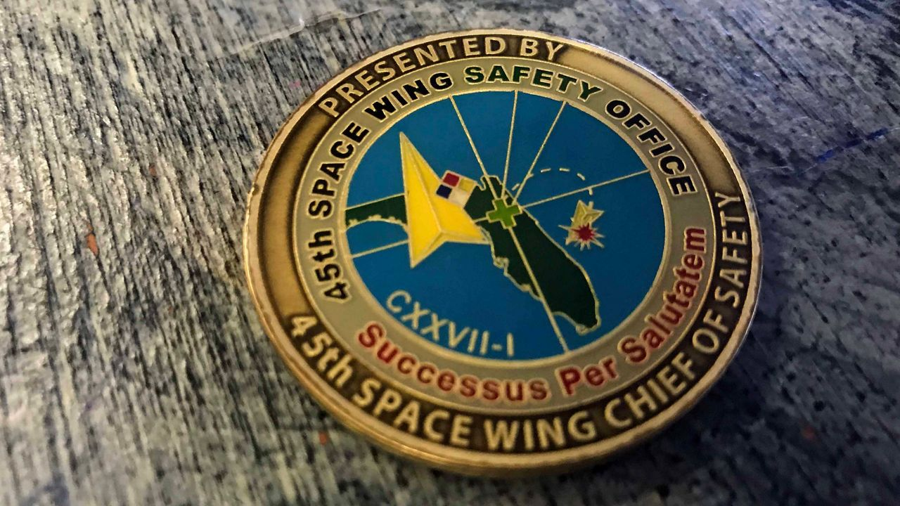 c6605601 45th Space Wing Coin Designer Helps in Search for Owner